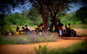 Children learning under trees in Kenya.