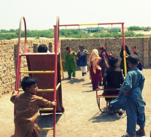 Children playing in school playground in Pakistan.